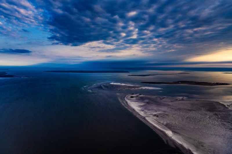 Sandbank- land area by flow under the sea water surface of North Sea in Japsand in the state Schleswig-Holstein, Germany