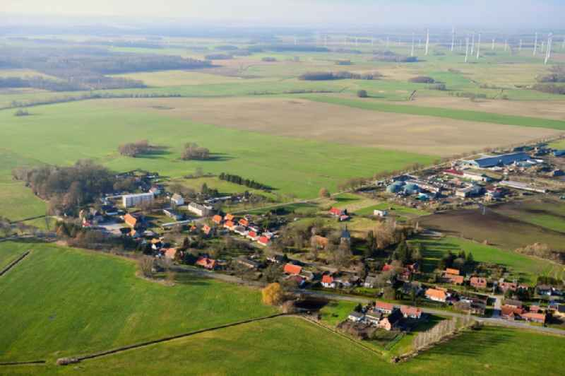 Agricultural land and field borders surround the settlement area of the village in Kambs in the state Mecklenburg - Western Pomerania, Germany