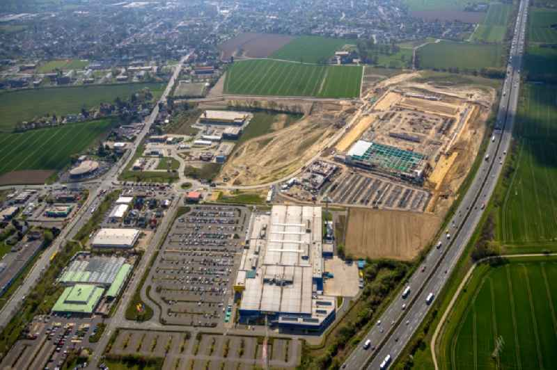 Construction site to build a new building complex on the site of the logistics center of Woolworth GmbH in the district Alte Colonie in Kamen in the state North Rhine-Westphalia, Germany. Further information at: DAL Deutsche Anlagen-Leasing GmbH & Co. KG,  DAeLKEN INGENIEURGESELLSCHAFT MBH,  Woolworth GmbH.