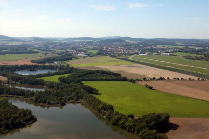 Riparian areas on the lake area of Deutsch-Baselitzer Grossteich in Kamenz in the state Saxony, Germany. In the background the Upper Lusatian hill country