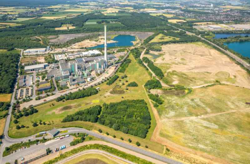 Power plants and exhaust towers of Waste incineration plant station Abfallentsorgungszentrum Asdonkshof Graftstrasse in Kamp-Lintfort in the state North Rhine-Westphalia, Germany