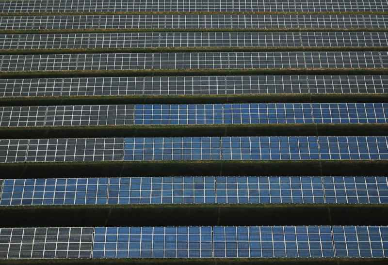 Panel rows of photovoltaic and solar farm or solar power plant in Kanena - Bruckdorf in the state Saxony-Anhalt, Germany