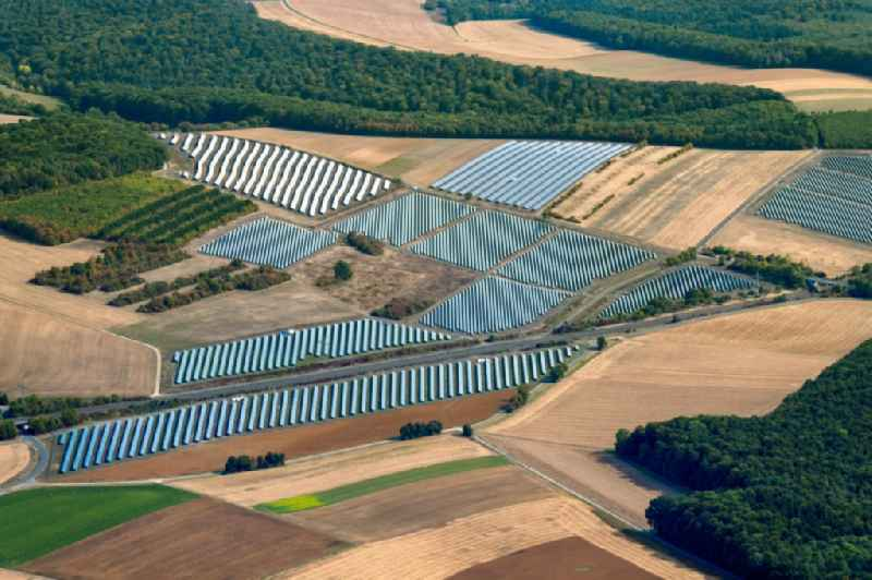 Panel rows of photovoltaic and solar farm or solar power plant of 'Buergersolarpark Laudenbach' of the 'GenoEnergie Karlstadt eG' in the district Rohrbach in Karlstadt in the state Bavaria, Germany