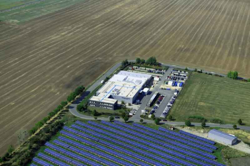 Panel rows of photovoltaic and solar farm or solar power plant along the Eisenberger Strasse - Lindenstrasse in Kleinhelmsdorf in the state Saxony-Anhalt, Germany