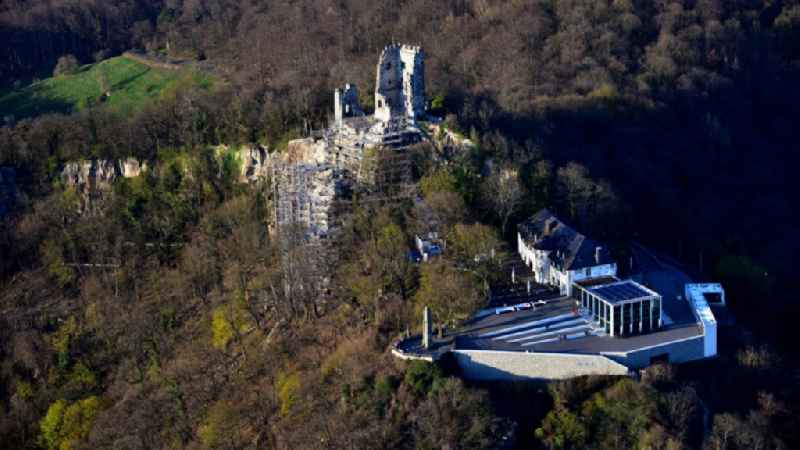 Ruins and vestiges of the former castle and fortress with scaffolding for renovation and the restaurant 'Drachenfels' on Drachenfels in Koenigswinter in the state North Rhine-Westphalia, Germany