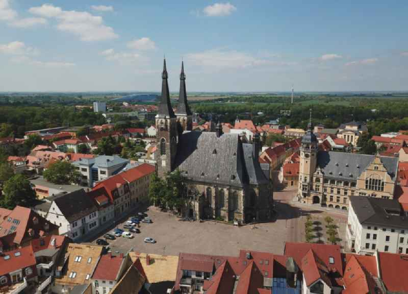 Church of Saint Jakob and town hall of Koethen (Anhalt) in the state of Saxony-Anhalt. A tower and parts of the town hall are scaffolded and being renovated