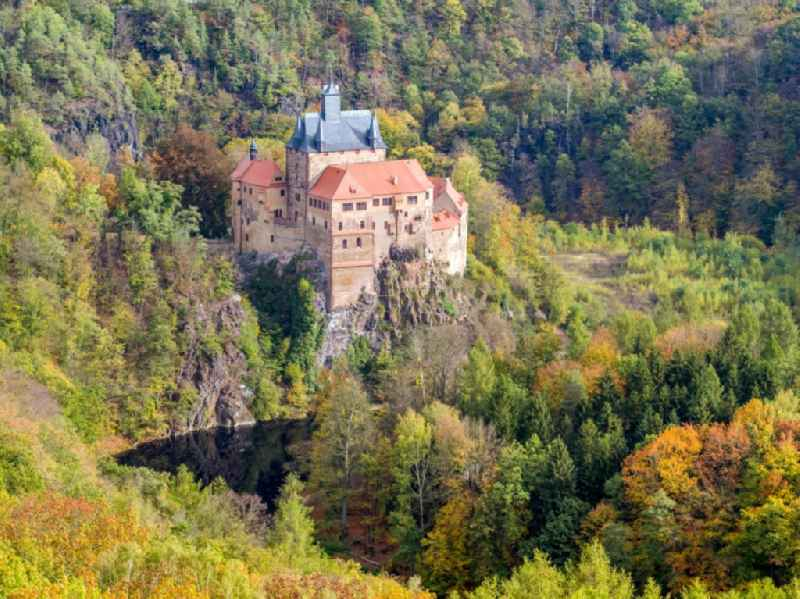 Autumnal discolored vegetation view castle of the fortress on Schlossberg in the district Kriebethal in Kriebstein in the state Saxony, Germany