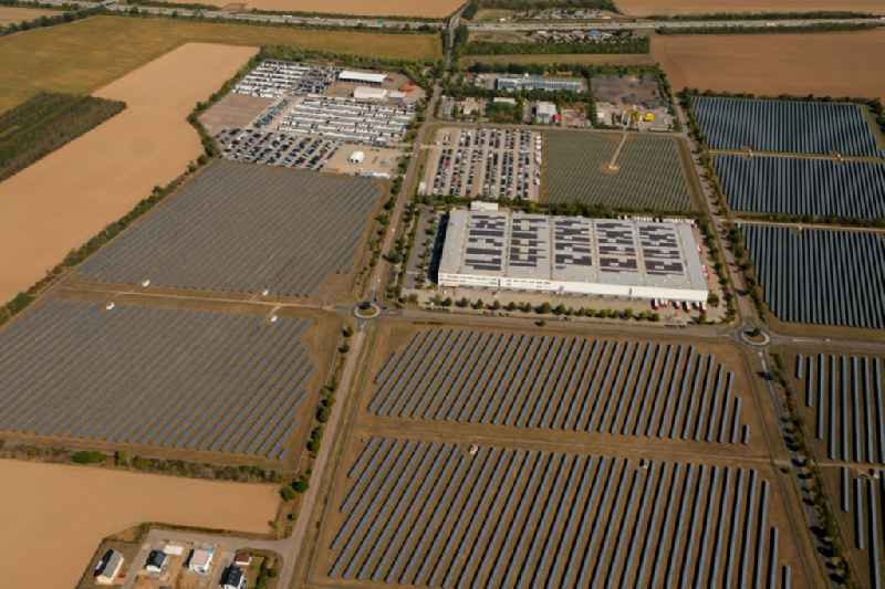 Panel rows of photovoltaic and solar farm or solar power plant in the commercial area in the district Sietzsch in Landsberg in the state Saxony-Anhalt, Germany