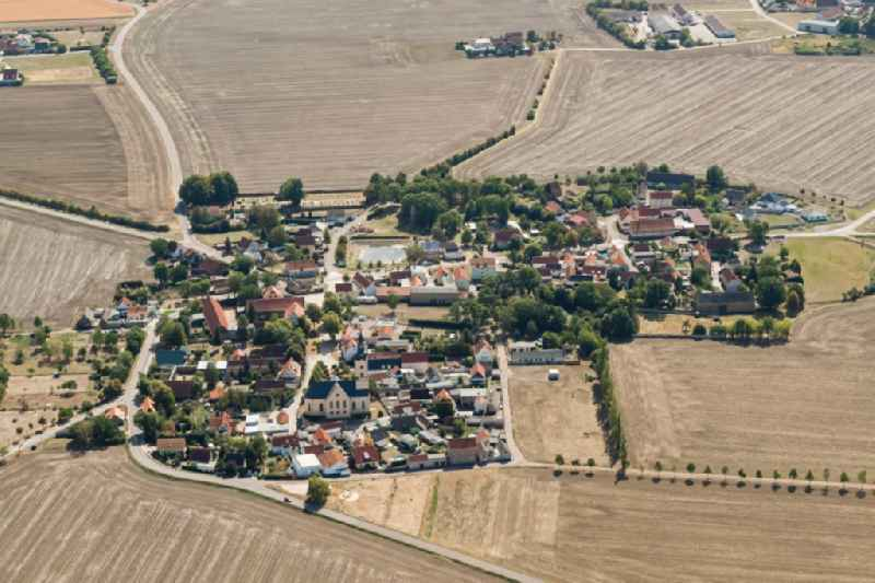 Agricultural land and field borders surround the settlement area of the village in Landsberg in the state Saxony-Anhalt, Germany