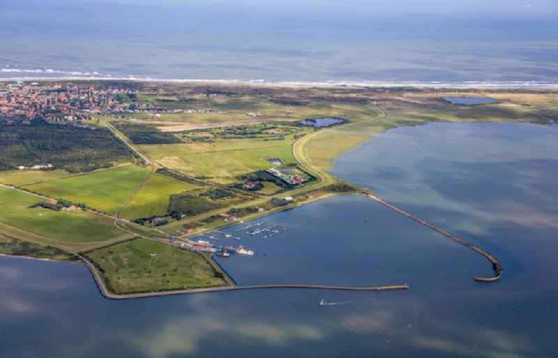 Pleasure boat marina with docks and moorings on the shore area on the coastal area of the North Sea in Langeoog in the state Lower Saxony, Germany