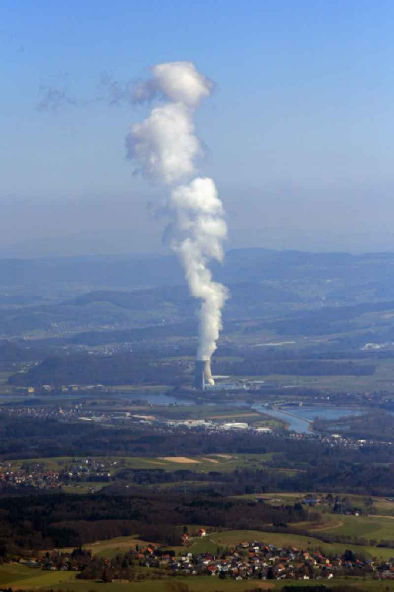 Looking over Rotzel, district of Laufenburg, in Baden-Wuerttemberg, Germany to the buildings, reactor, cooling tower and facilities of the NPP nuclear power plant KKL in Leibstadt in the canton Aargau, Switzerland. The river Rhine is border between Germany and Switzerland