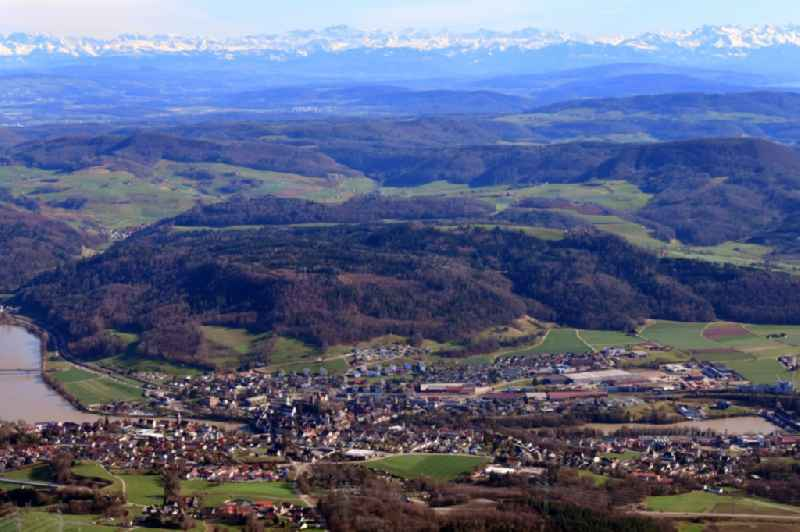 City area and river Rhine in Laufenburg in the state Baden-Wurttemberg, Germany. Clear view over Switzerland to the mountain range of the Swiss Alps