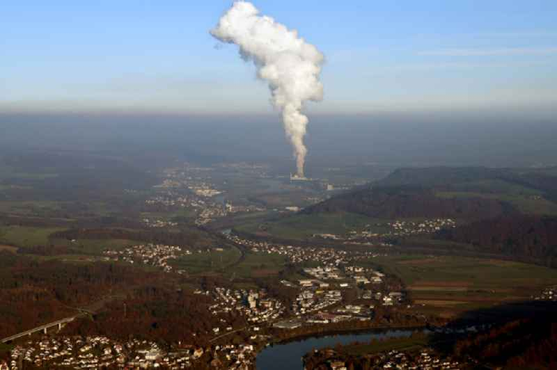 Landscape at the Rhine - river in Laufenburg in the state Baden-Wurttemberg, Germany. Steam column of the NPP nuclear power plant KKL Leibstadt in Switzerland