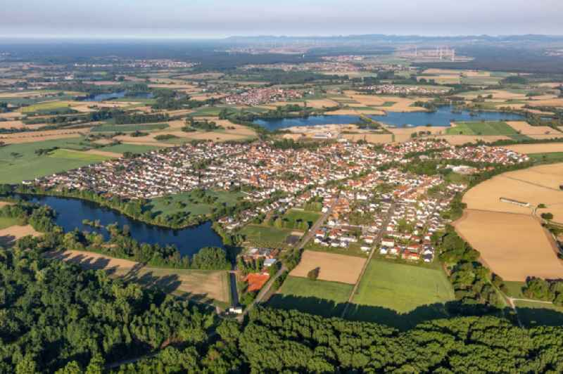 Village - view on the edge of agricultural fields and farmland in Leimersheim in the state Rhineland-Palatinate