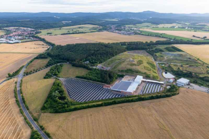Panel rows of photovoltaic and solar farm or solar power plant on an old landfill of Kommunaler Abfallservice of Landkreises Gotha in Leinatal in the state Thuringia, Germany