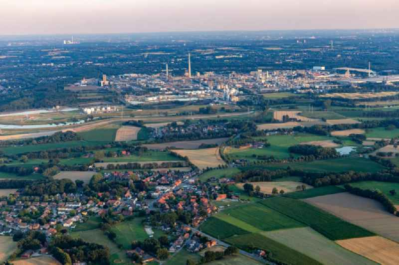 Village view on the edge of agricultural fields and land in Lippramsdorf in the state North Rhine-Westphalia, Germany