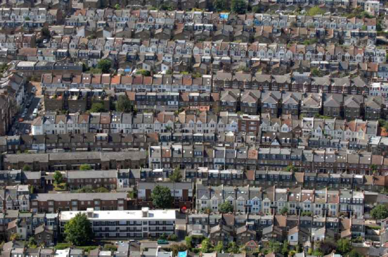 View of residential areas in the district Fulham, London. You can see various residential complexes with row houses.