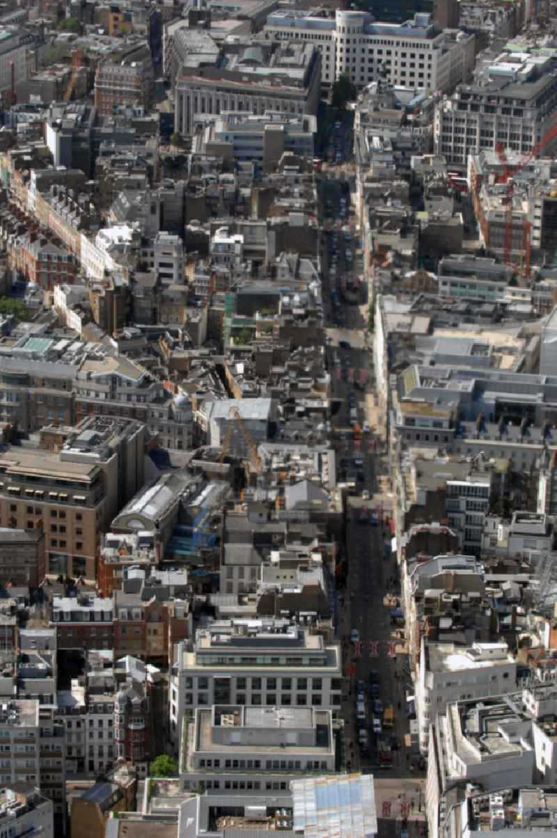 View over the in the city part Mayfair located Bond Street in the District City of Westminster in London in the county of Greater London in the UK. Bond Street is considered one of the most popular shopping streets in London.