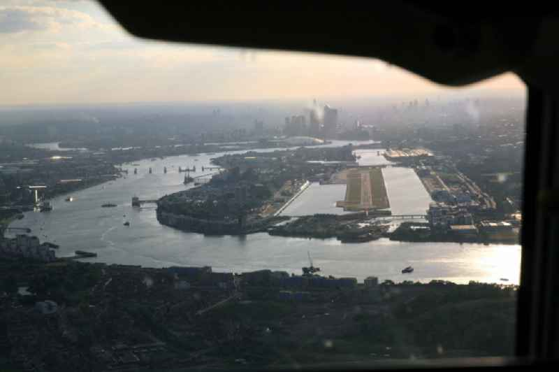 View from the cockpit while approaching the London City Airport in the Docklands of London in the UK. The commercial airport ( ICAO code : EGLC ) is utilized because of its proximity to the city center and downtown especially for business travel.