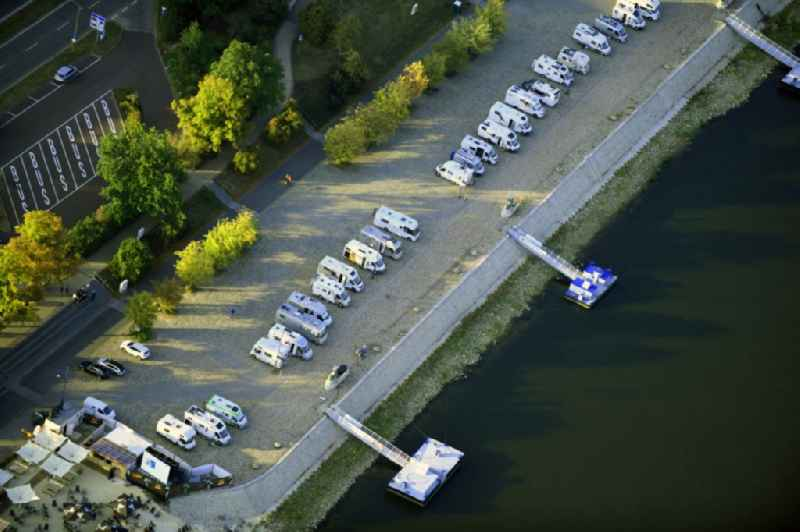 Caravans and RVs on the RV site ' Magdeburg Petrifoerderer ' on elbe river shore in the district Zentrum in Magdeburg in the state Saxony-Anhalt, Germany.