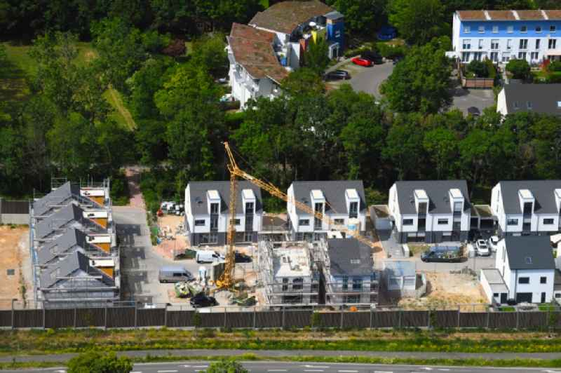Construction sites for new construction residential area of detached housing estate 'Wohnquartier on Lerchenberg' with terraced houses on Nino-Erne-Strasse in the district Lerchenberg in Mainz in the state Rhineland-Palatinate, Germany
