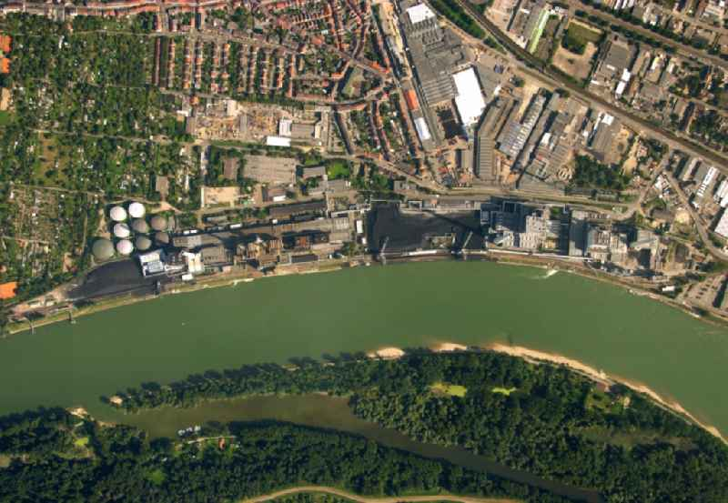 Power plants and exhaust towers of coal thermal power station Grosskraftwerk Mannheim AG at the shore of the Rhine river near Neckarau on street Plinaustrasse in Mannheim in the state Baden-Wurttemberg, Germany