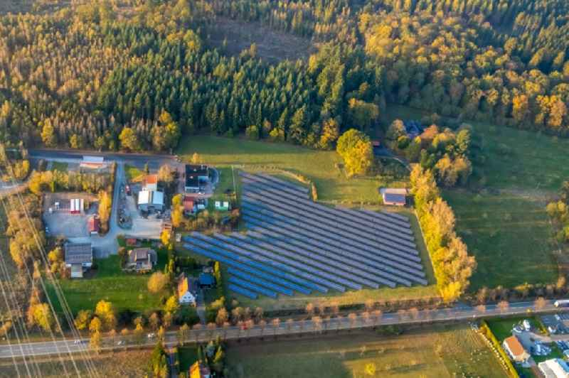 Panel rows of photovoltaic and solar farm or solar power plant along the Carl-Reinke-Strasse in the district Bredelar in Marsberg in the state North Rhine-Westphalia, Germany