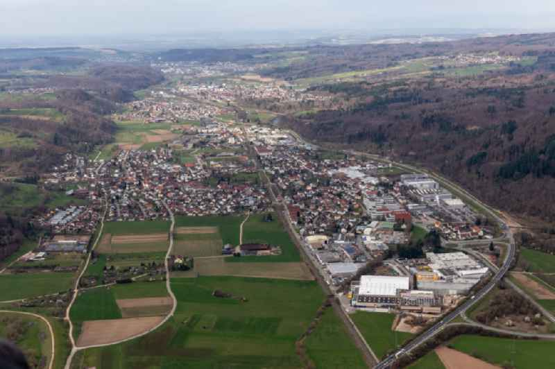 Location view of the streets and houses of residential areas in the valley landscape of the Wiese river surrounded by mountains in Maulburg in the state Baden-Wuerttemberg, Germany