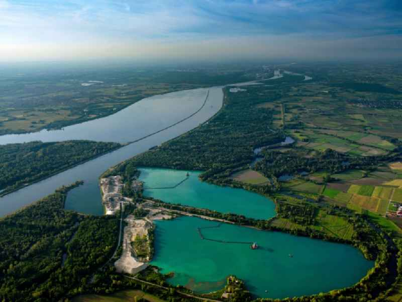 The excavated lakes on the Rhine riverbank in Meissenheim in the state of Baden-Wuerttemberg. The split quarry pond is located in the North of the town on the Eastside of the river which forms the border to France. The lakes are surrounded by the Old Rhine