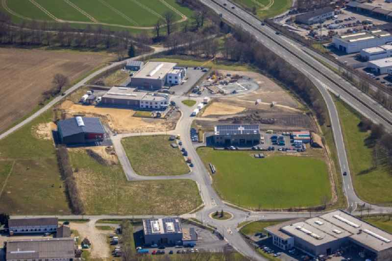 New building construction site in the industrial park 'Auf dem Bruch' overlooking the company buildings of 'Eventtechnik Suedwestfalen' and the 'JUMA Logistik GmbH' in the district Enste in Meschede in the state North Rhine-Westphalia, Germany