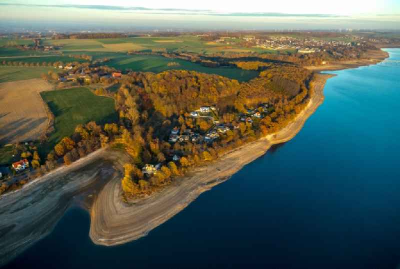 Low water level and lack of water caused the shoreline areas to be exposed of Stausees on Moehnetalsperre in Moehnesee in the state North Rhine-Westphalia, Germany
