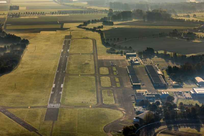 Runway with hangar taxiways and terminals on the grounds of the airport of 'Flughafengesellschaft Moenchengladbach GmbH' on Flughafenstrasse district Giesenkirchen in Moenchengladbach in the state North Rhine-Westphalia, Germany