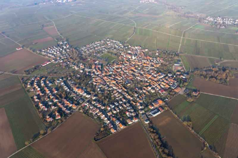Agricultural land and field borders surround the settlement area of the village in Moerzheim in the state Rhineland-Palatinate, Germany
