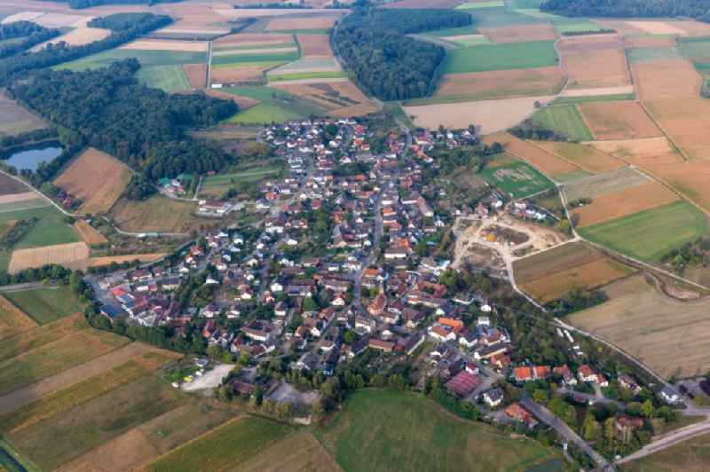 Agricultural land and field borders surround the settlement area of the village in Moos in the state Baden-Wuerttemberg, Germany