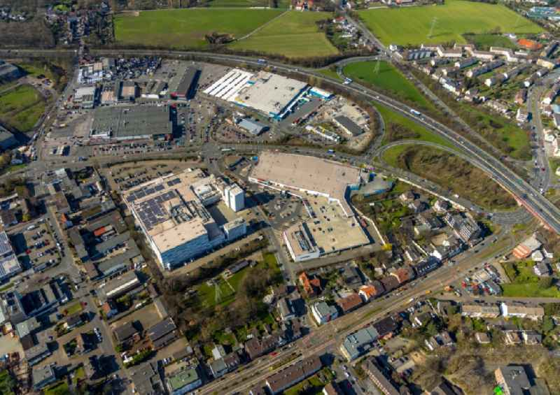 Industrial estate and company settlement with shopping malls and the 'Aldi Kaffeeroesterei' along the Mannesmannallee in Muelheim on the Ruhr in the state North Rhine-Westphalia, Germany