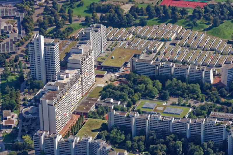 Building of the Olympiadorf residential complex in Munich, Bavaria. The one-storey bungalows and several high-rise buildings and terraces of the former Olympic village are used as the student dormitory.