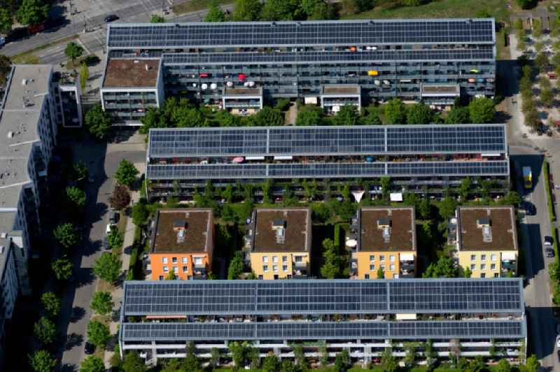 Residential area of a??a??a row house settlement with solar roofs on the Centa-Herker-Bogen in Schwabing-West in Munich in the state Bavaria, Germany