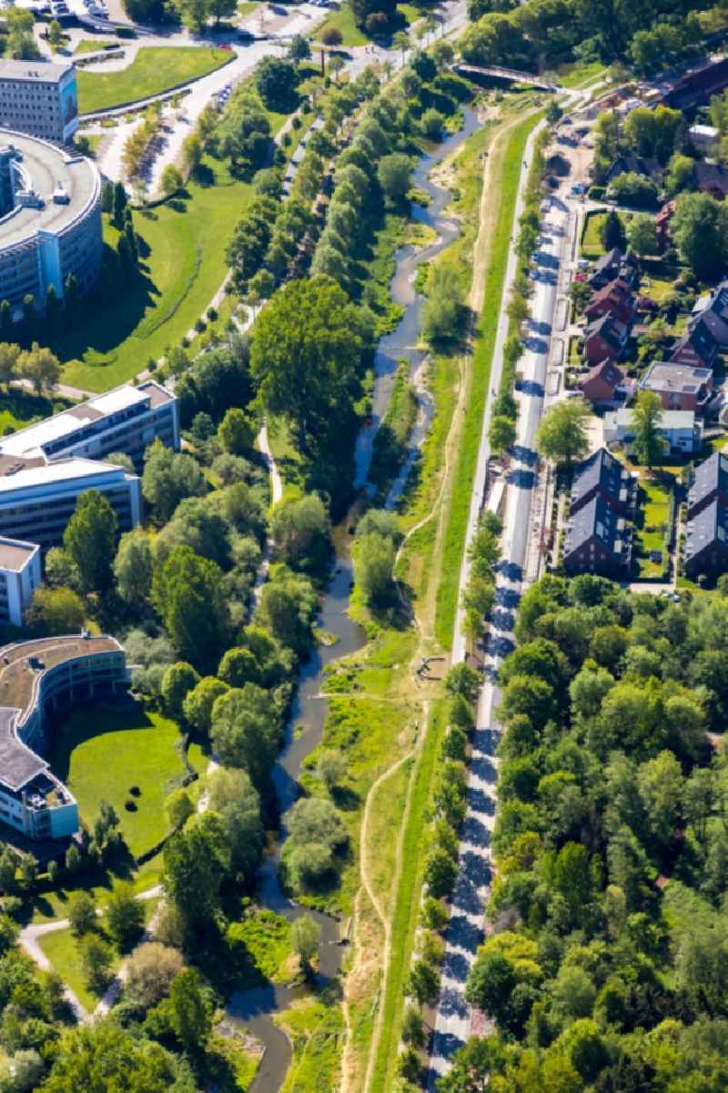 Curved loop of the riparian zones on the course of the river Muenstersche Aa along the Kanalstrasse in the district Rumphorst in Muenster in the state North Rhine-Westphalia, Germany