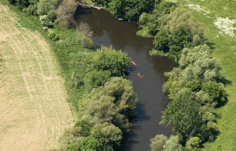 Canoeists - ride on the Saale in the district Bad Koesen in Naumburg (Saale) in the state Saxony-Anhalt, Germany
