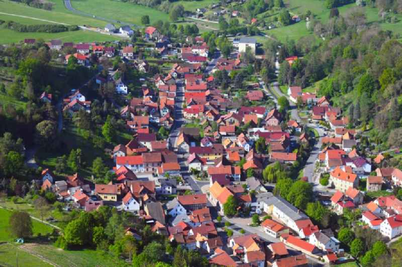 Location view of the streets and houses of residential areas in the valley landscape surrounded by mountains in Nazza in the state Thuringia, Germany