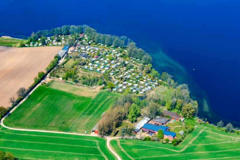 Caravan and tents - Camping Jochen Bruene - and tent site on Lake Ploen in Nehmten in the state Schleswig-Holstein, Germany