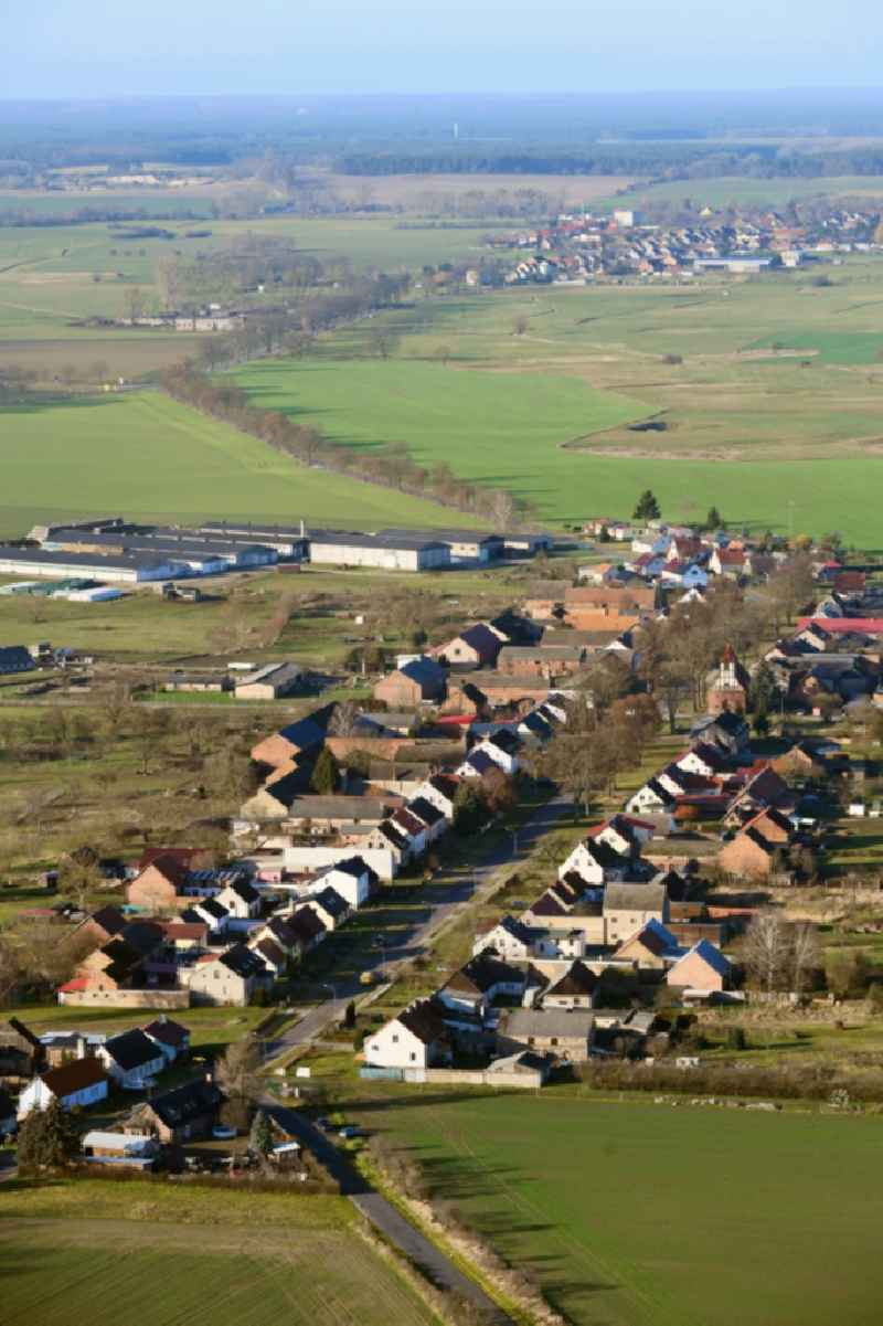 Agricultural land and field borders surround the settlement area of the village in Neuloegow in the state Brandenburg, Germany