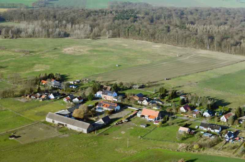 Agricultural land and field borders surround the settlement area of the village in Neuluedersdorf in the state Brandenburg, Germany