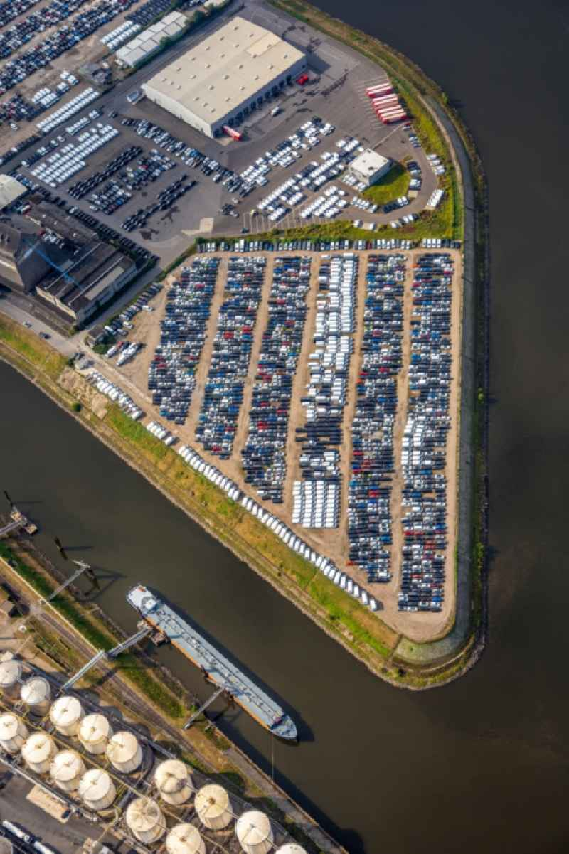 Automobiles - cars on the parking spaces in the outdoor area of inland port in Neuss in the state North Rhine-Westphalia, Germany