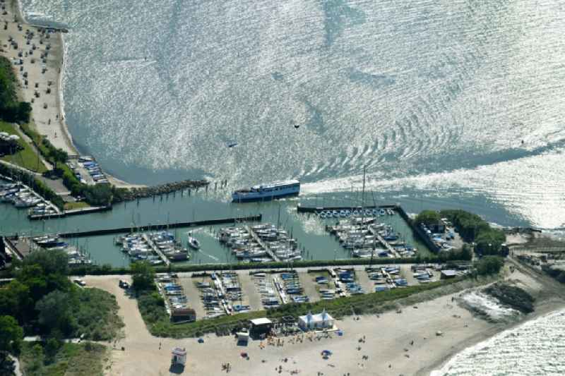 Pleasure boat marina with docks and moorings on the shore area on Strandstrasse in Niendorf/Ostsee in the state Schleswig-Holstein, Germany