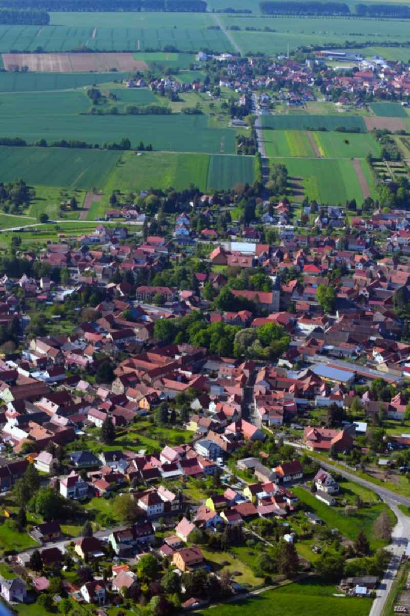 Village view on the edge of agricultural fields and land in Oberdorla in the state Thuringia, Germany