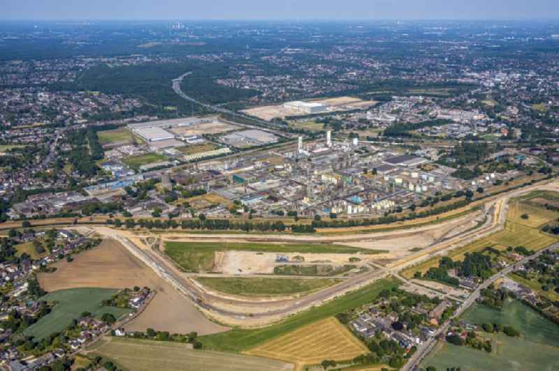 Development area and building land fallow with a construction site of ' EMSCHERGENOSSENSCHAFT / LIPPEVERBAND ' at Holtener Bruch overlooking the technical facilities of the chemical plant of 'AIR LIQUIDE Deutschland GmbH' in Oberhausen in the state North Rhine-Westphalia, Germany