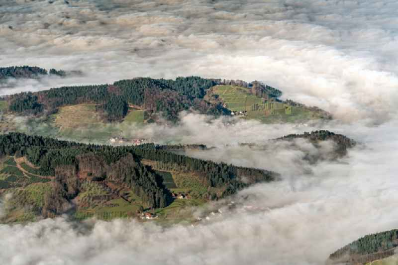 Weather with layered fog cover over the Black Forest in Oberkirch in the state Baden-Wurttemberg, Germany.