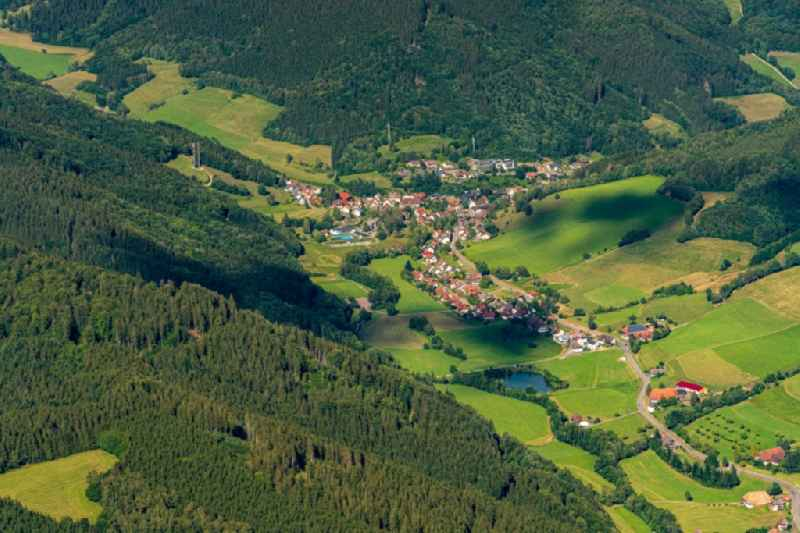 Location view of the streets and houses of residential areas in the valley landscape surrounded by mountains in Oberprechtal in the state Baden-Wuerttemberg, Germany