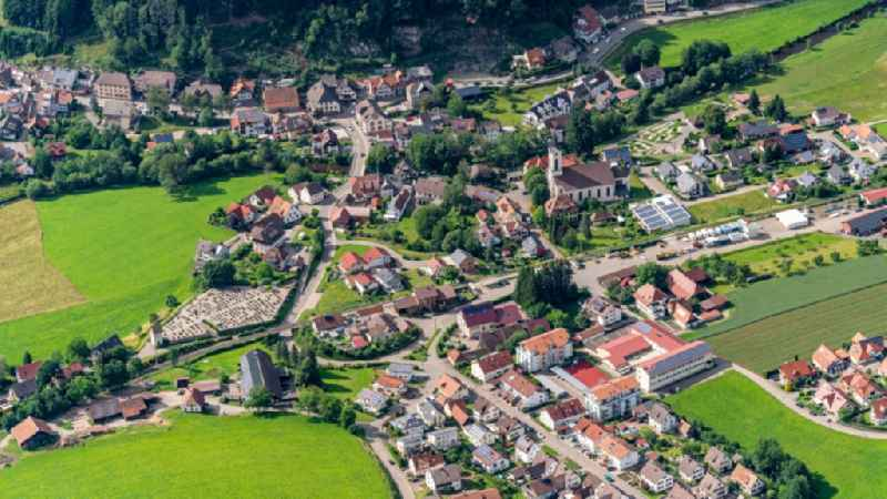 Location view of the streets and houses of residential areas in the valley landscape surrounded by mountains in Oberwinden in the state Baden-Wuerttemberg, Germany